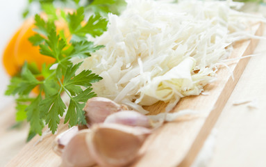 Finely chopped cabbage on wooden board