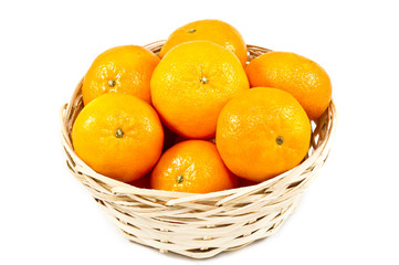 Tangerines (mandarin)  in a straw cup