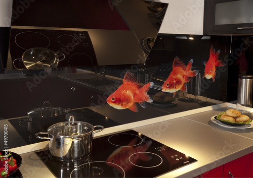 modern kitchen and a stove with a pan