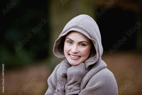 A woman wrapped up in warm clothes in autumn time