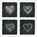 Set of hand drawn hearts on chalkboard background.