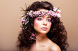 Luxuriant. Femininity. Fashion Model with Wreath of Flowers