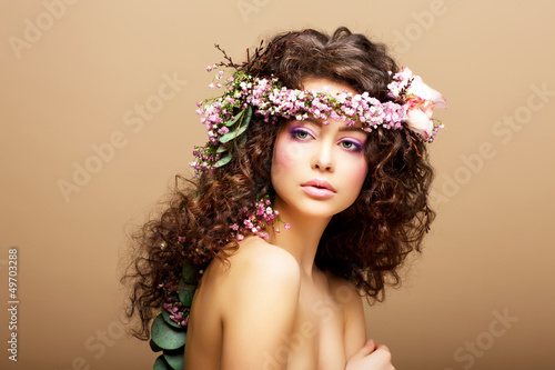 8 March. Springtime. Woman with Wreath of Flowers over beige