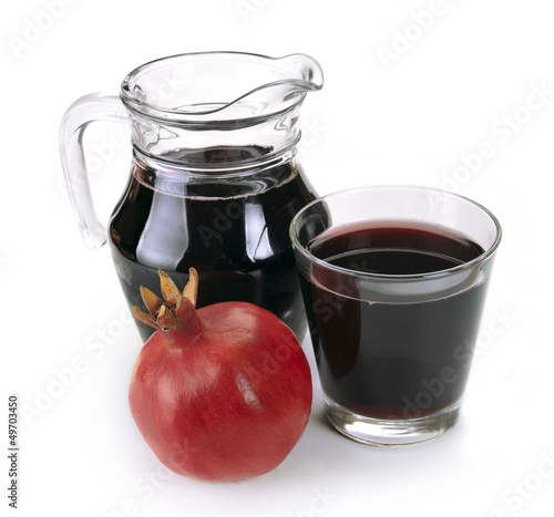 Jug of juice and ripe piece grenade