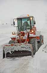 snow plough scraper with the bucket to remove all the snow