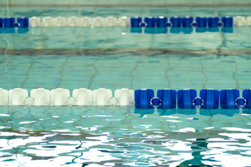 Empty swimming pool with blue and white lane dividers