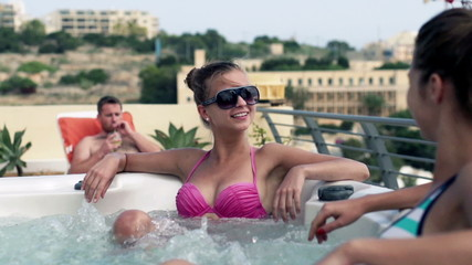 Female friends relaxing in jacuzzi, slow motion shot at 240fps