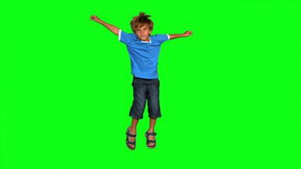 Boy jumping on green screen