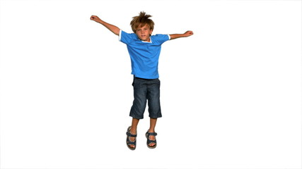 Boy jumping on a white background