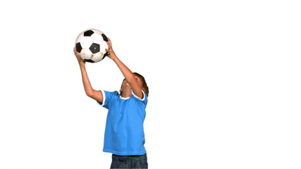Boy jumping and catching football