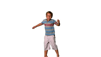 Boy jumping up and down on a white background