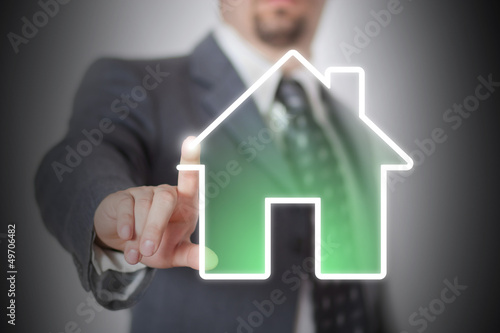 Businessman drawing an house with his finger