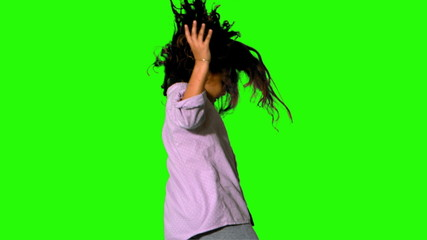 Little girl jumping and turning on green screen