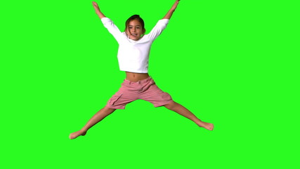 Little girl jumping on green screen