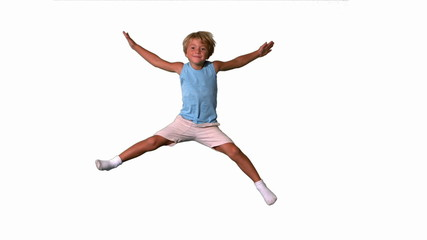 Boy jumping with limbs outstretched on white background