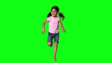 Cute little girl jumping on green screen