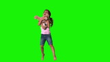 Cute little girl jumping and catching teddy on green screen