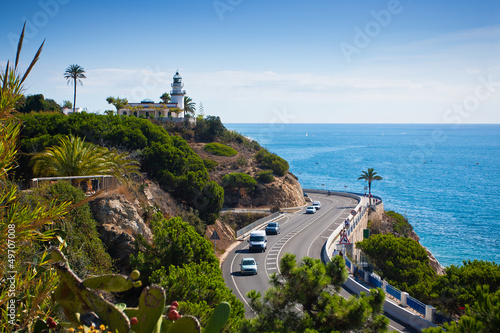 Lighthouse, sea and road near Calella, Spain