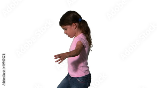Cute little girl spinning around on white background
