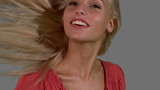 Attractive blonde shaking her hair up