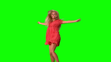 Attractive blonde jumping on green screen