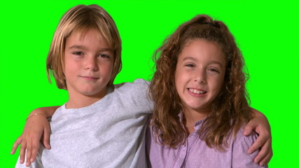 Siblings smiling on green screen