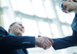 Business shaking hands with copy space (selective focus)