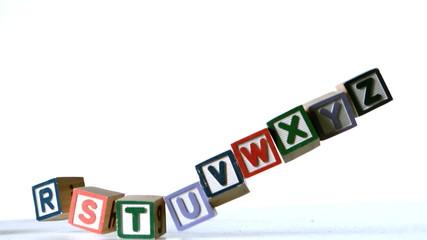 Separated alphabet blocks falling over