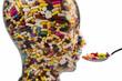Kopf aus Glas mit Tabletten