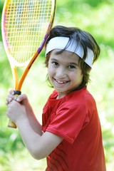 Kid playing tennis