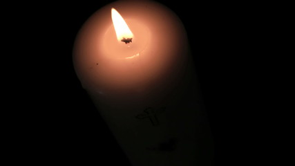 Candle burning brightly