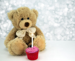 Bear with cake and candle.