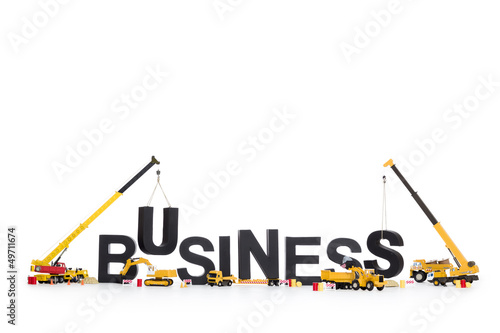 Build up a business: Machines building business-word.