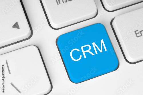 Blue CRM keyboard button .