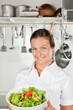 Female Chef Holding Bowl Of Salad