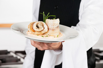 Waiter Presenting Salmon Roll