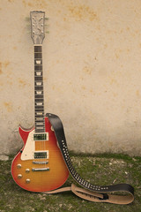 vintage guitar and wall