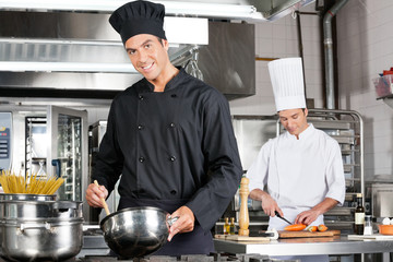 Chefs Cooking Food In Kitchen