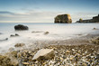 Marsden Rock in smooth water