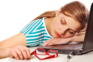 girl sleeping on her laptop