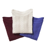 Three folded sweaters