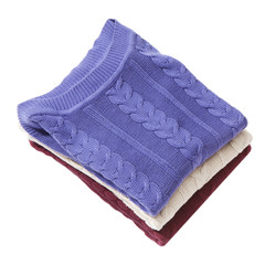 Pile of three folded sweaters