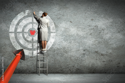 Business woman pointing target