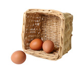 Two eggs in a basket and one separately