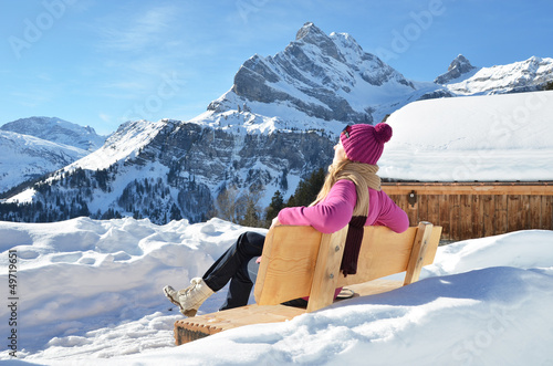 Traveler enjoying Alpine panorama. Switzerland