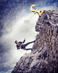 busiessman climbing mountain