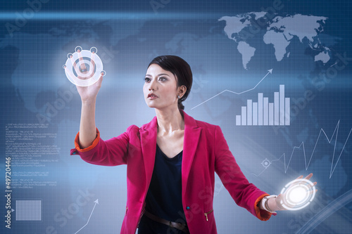 Businesswoman and global touchscreen
