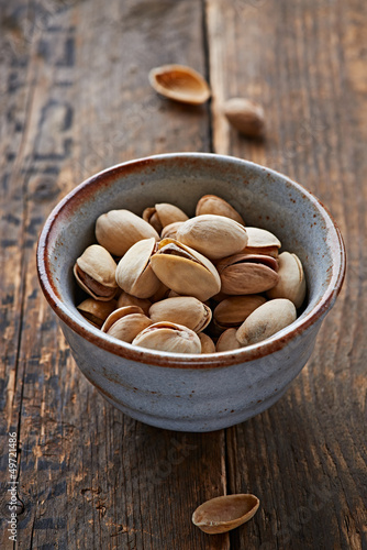 Pistachios in a small ceramic bowl