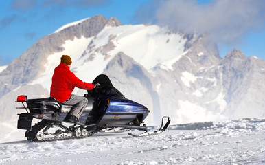 Any man on the snowmobile in The Alps.