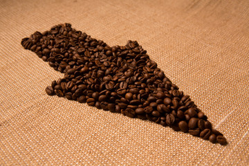 Arrow from the coffee beans isolated on burlap